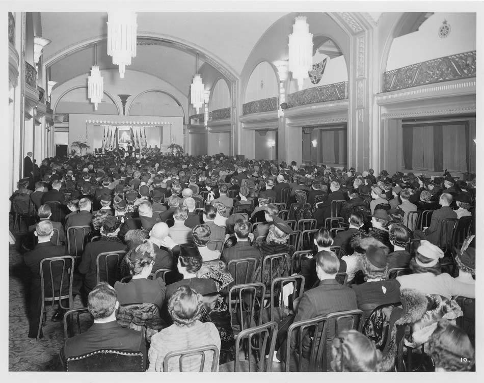 vintage photo of several people gathered for book fair event at arcadian court in toronto