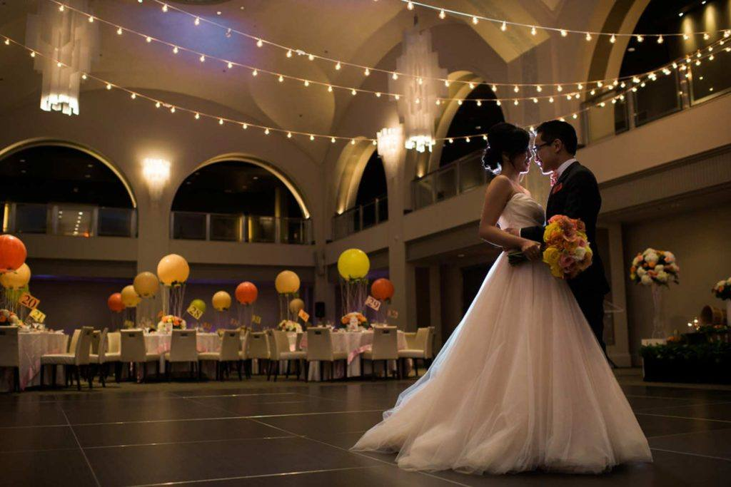 Bride and groom enjoying their first dance at Arcadian Court in Toronto
