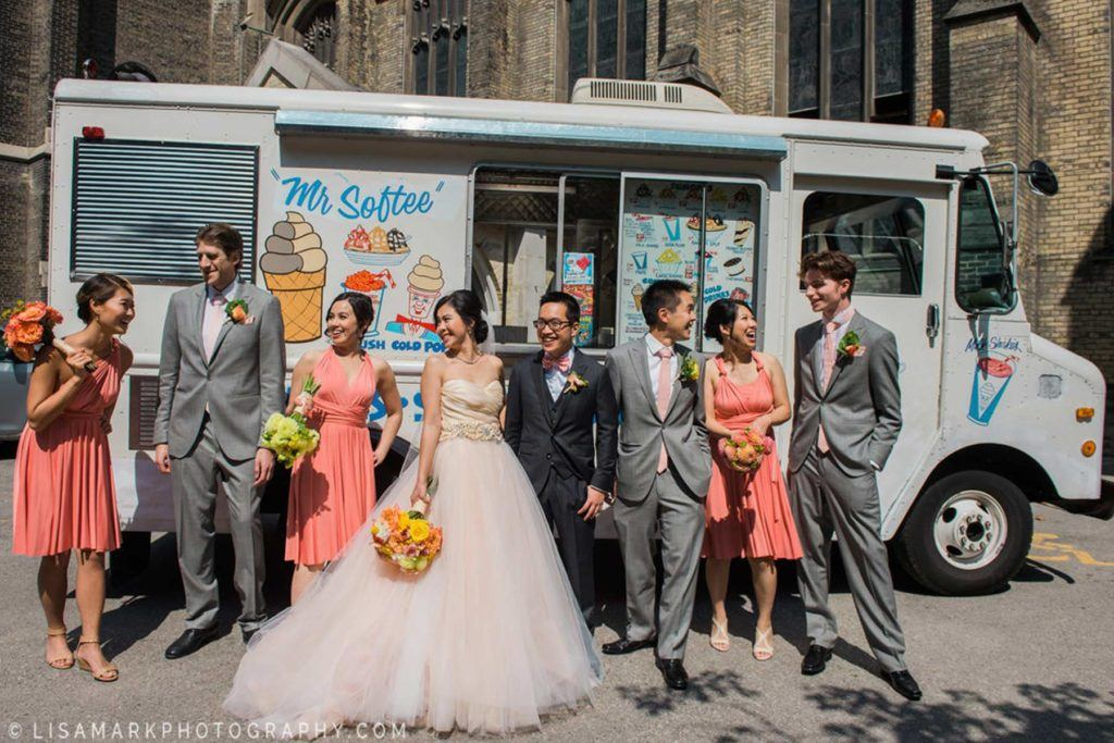 Wedding party and ice cream truck standing outside
