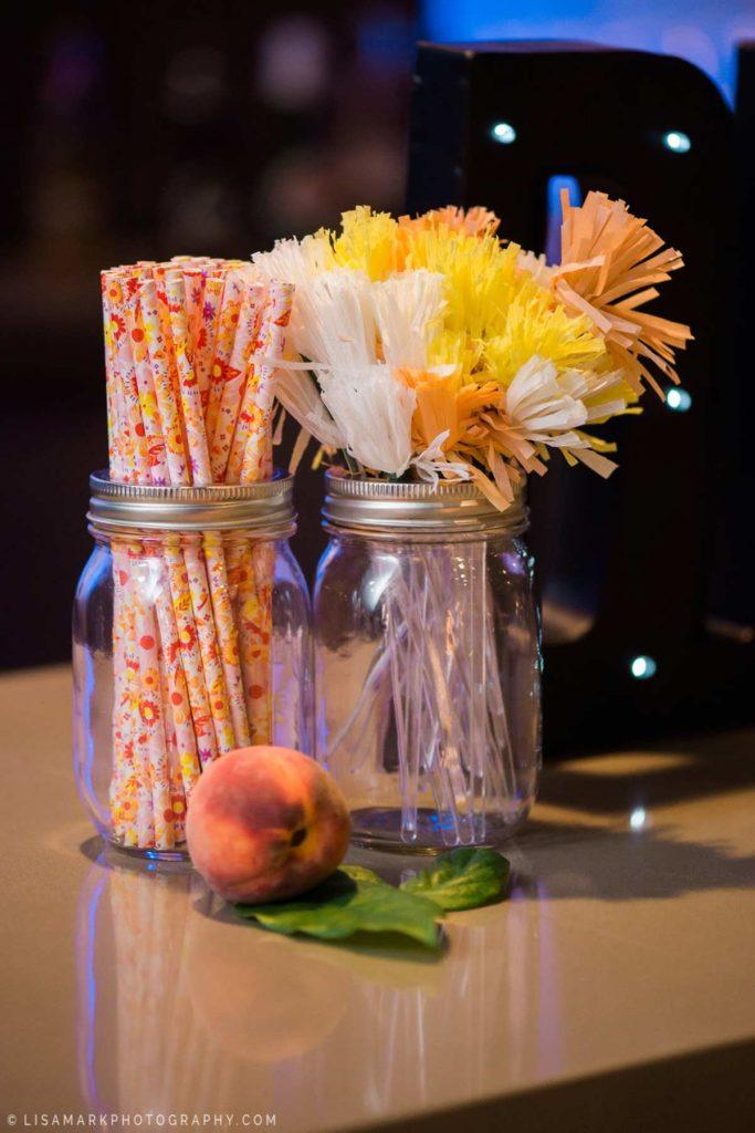 Straws and peaches on the bar at a wedding reception at Arcadian Court