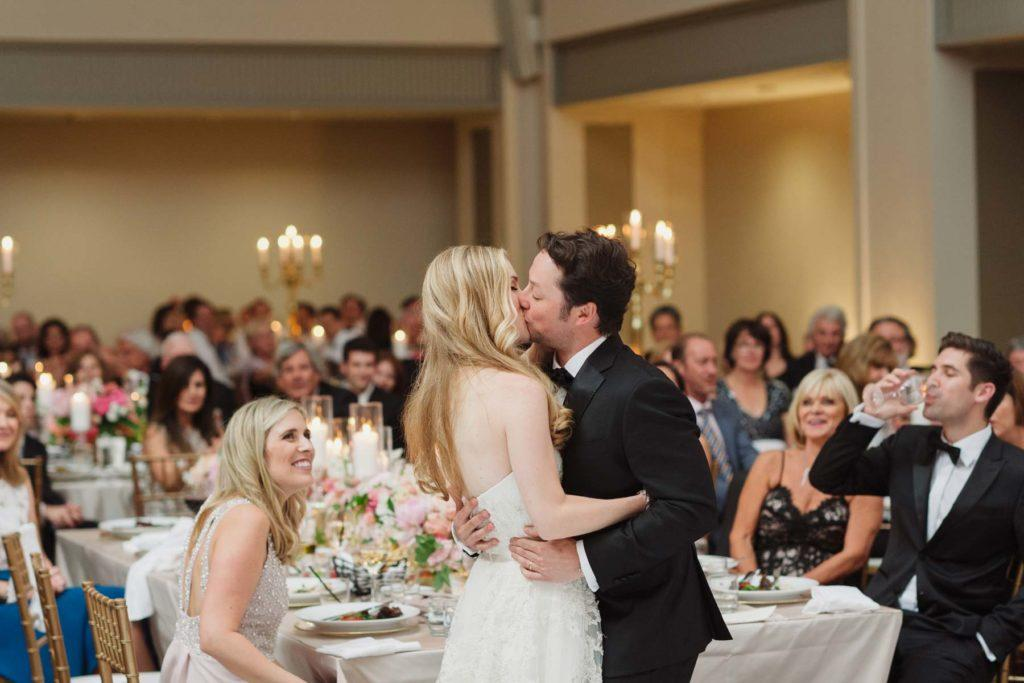 Bride and groom kissing during their wedding reception at Arcadian Court in Toronto