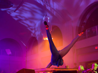 Acrobat performing on stage at Arcadian Court in Toronto