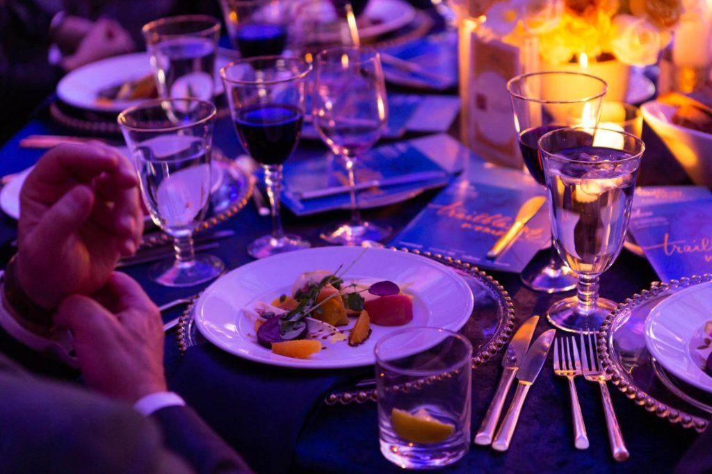 Plated dinner on a set table at Arcadian Court in Toronto